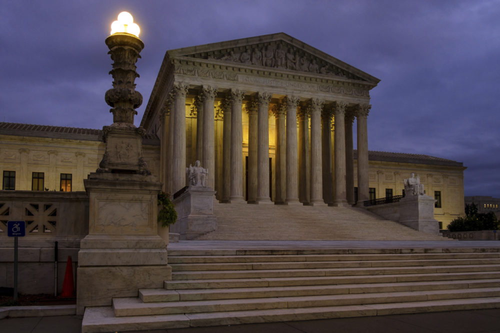 The U.S. Supreme Court building stands quietly before dawn in Washington, Friday, Oct. 5, 2018. (J. David Ake/AP)