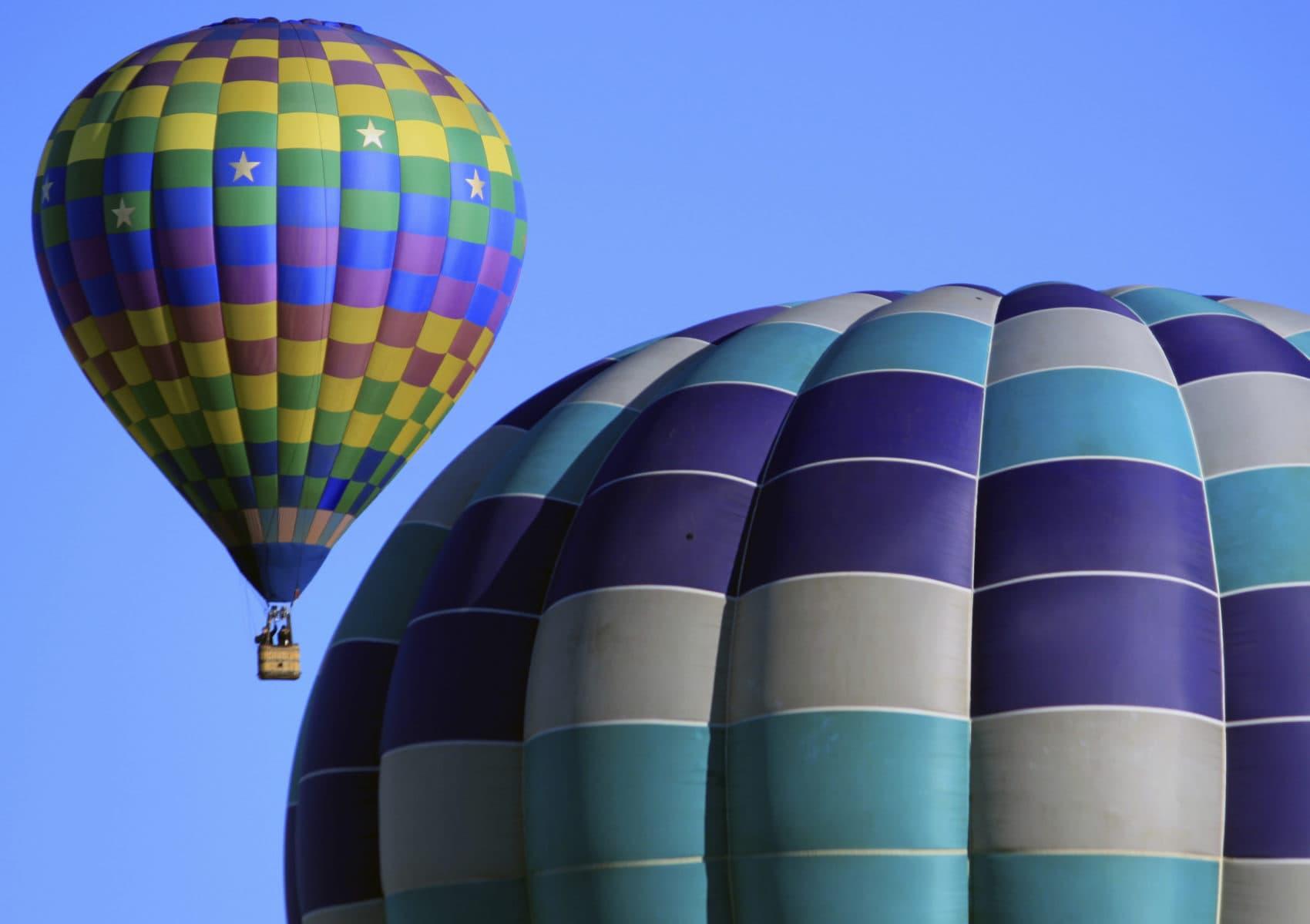 Hot air balloons participating in the Albuquerque International Balloon Fiesta float over Albuquerque, N.M., Oct. 10, 2017. The 47th Albuquerque International Balloon Fiesta is set to start Saturday, Oct. 6, 2018. (Susan Montoya Bryan/AP)