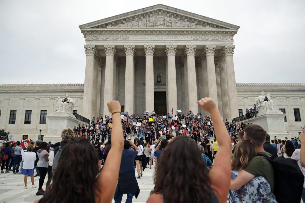 Activists protest on the steps and plaza of the Supreme Court after the confirmation vote of Brett Kavanaugh on Saturday. (Alex Brandon/AP)