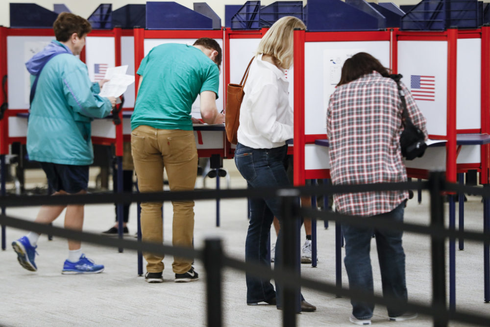 Voters fill out their ballots at the Hamilton County Board of Elections on the first day of early voting, Wednesday, Oct. 10, 2018, in Cincinnati. (John Minchillo/AP)