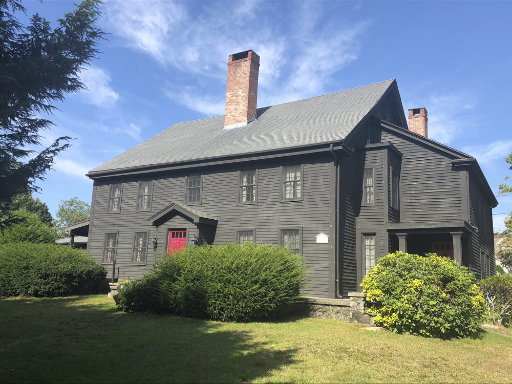 In this Sept. 17, 2018, photo provided by J Barrett & Company, a house in Peabody, Mass., built in 1638 that was once home to John Proctor, a victim of the Salem witch trials, is shown. The six-bedroom, two-bathroom home in Peabody, which at the time was part of Salem, is on the market for $600 thousand. (Joseph Cipoletta/ Barrett & Company via AP)