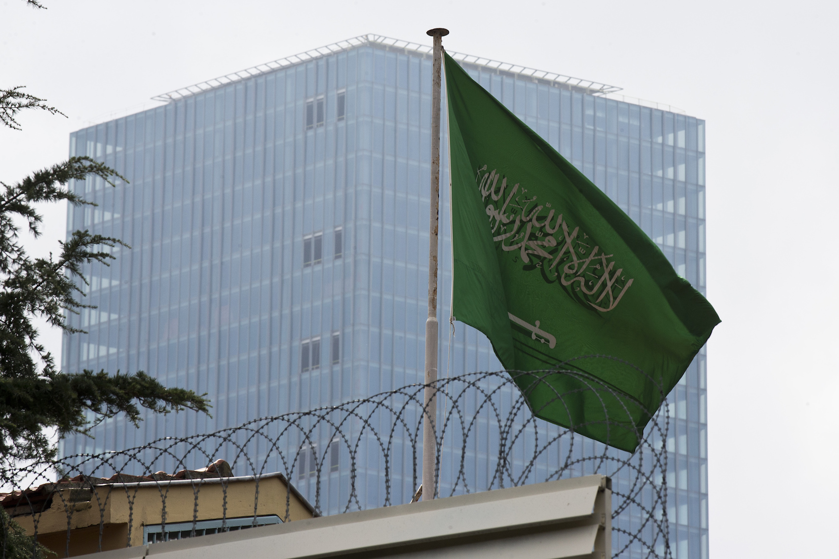 """A Saudi Arabia flag flies on the roof of Saudi Arabia's consulate in Istanbul, Friday, Oct. 12, 2018. A senior Turkish official says Turkey and Saudi Arabia will form a """"joint working group"""" to look into the disappearance of Saudi writer Jamal Khashoggi. (AP Photo/Petros Giannakouris)"""