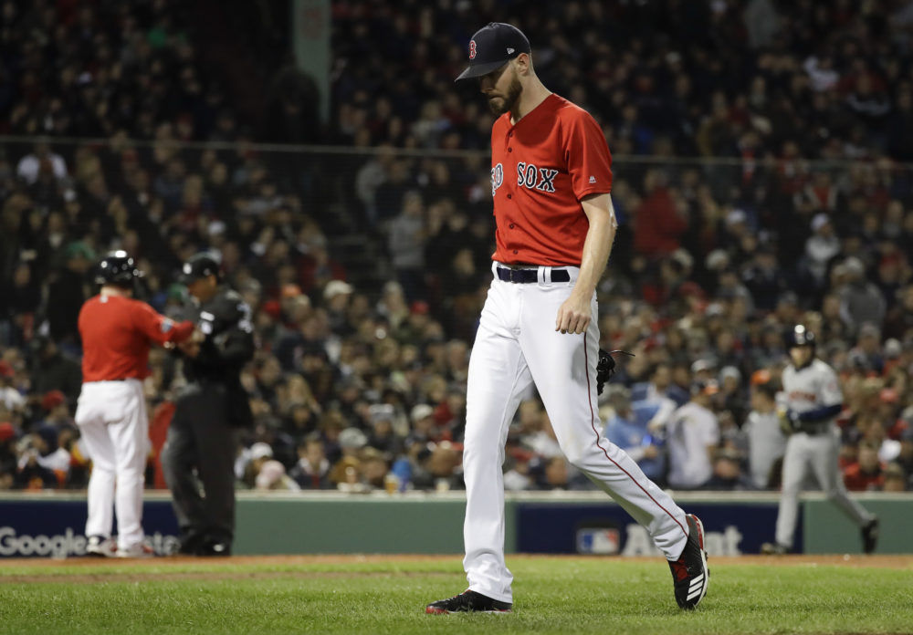 Boston Red Sox starting pitcher Chris Sale walks to the dugout after giving up two runs against the Houston Astros during the second inning in Game 1 of a baseball American League Championship Series on Saturday, Oct. 13, 2018, in Boston. (David J. Phillip/AP)