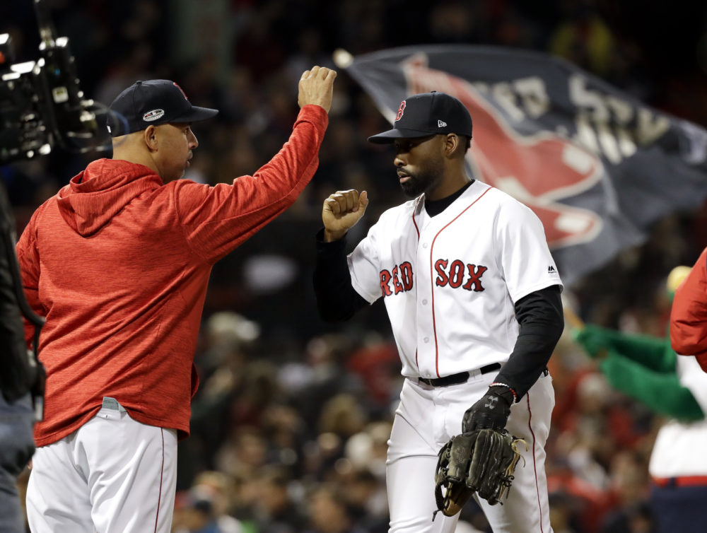 Boston Red Sox manager Alex Cora, left, and center fielder Jackie Bradley Jr. celebrate after their win against the Houston Astros in Game 2 of a baseball American League Championship Series on Sunday, Oct. 14, 2018, in Boston. (David J. Phillip/AP)