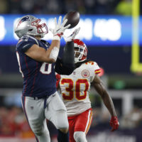 New England Patriots tight end Rob Gronkowski, left, catches a pass in front of Kansas City Chiefs safety Josh Shaw (30) during the second half of an NFL football game, Sunday, Oct. 14, 2018, in Foxborough. (Michael Dwyer/AP)