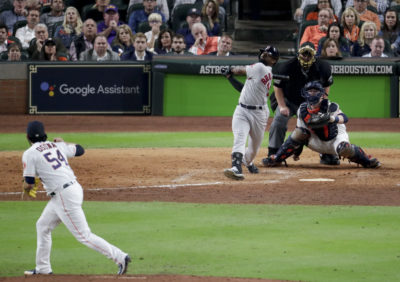 Boston Red Sox's Jackie Bradley Jr. watches his grand slam off Houston Astros relief pitcher Roberto Osuna during the eighth inning in Game 3 on Tuesday. (Lynne Sladky/AP)