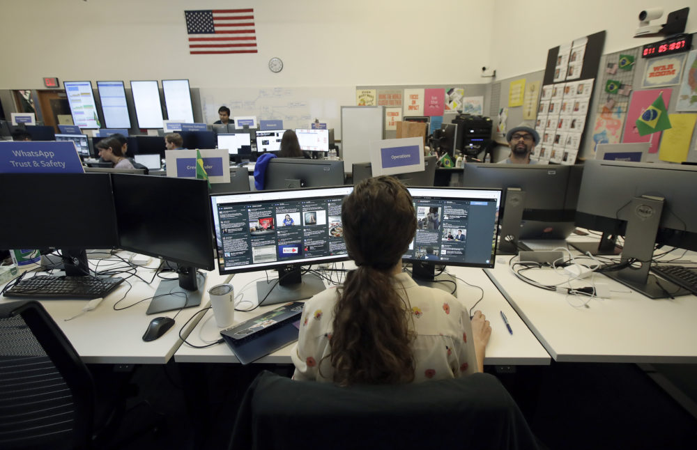 Lexi Sturdy, election war room lead, sits at her desk during a demonstration in the war room, where Facebook monitors election related content on the platform, in Menlo Park, Calif., Wednesday, Oct. 17, 2018. (Jeff Chiu/AP)