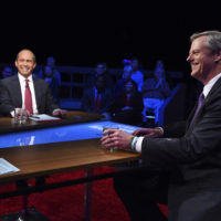Republican Gov. Charlie Baker, right, and Democratic challenger Jay Gonzalez wait to be introduced prior to a televised debate at the studios of WBGH-TV in Boston on Wednesday. (Meredith Nierman/WGBH-TV via AP, Pool)