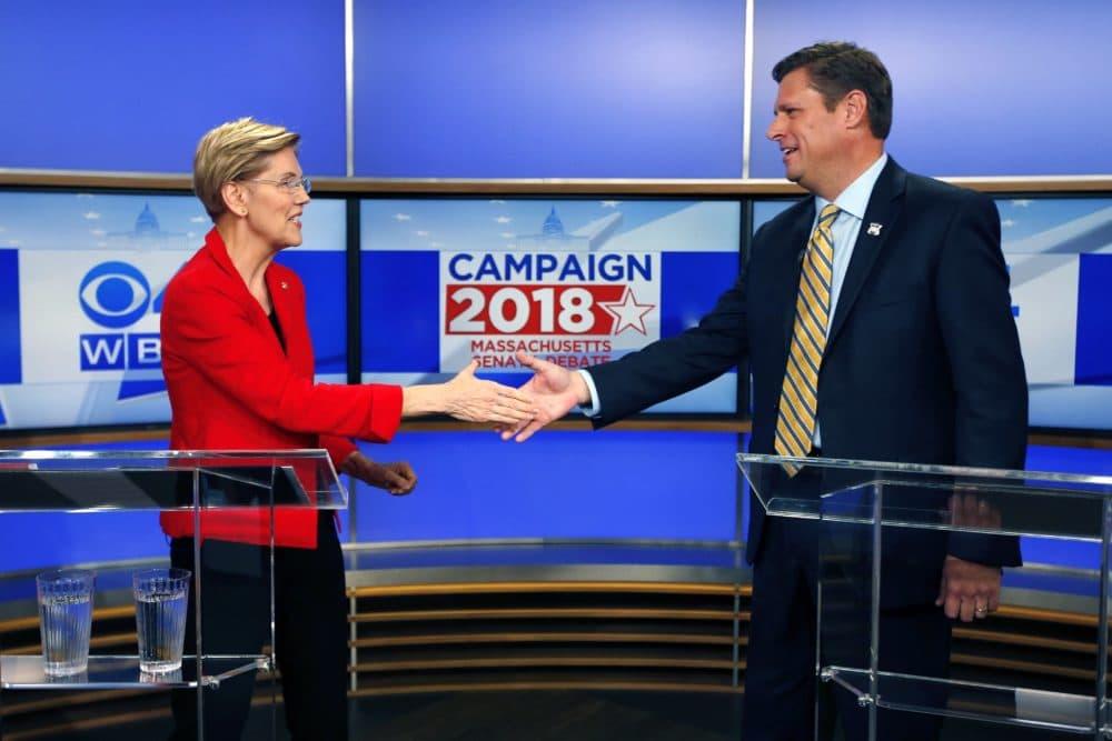 Massachusetts Senate candidates Sen. Elizabeth Warren, left, and her opponent State Rep. Geoff Diehl shake hands before a debate in Boston. (Michael Dwyer/AP)