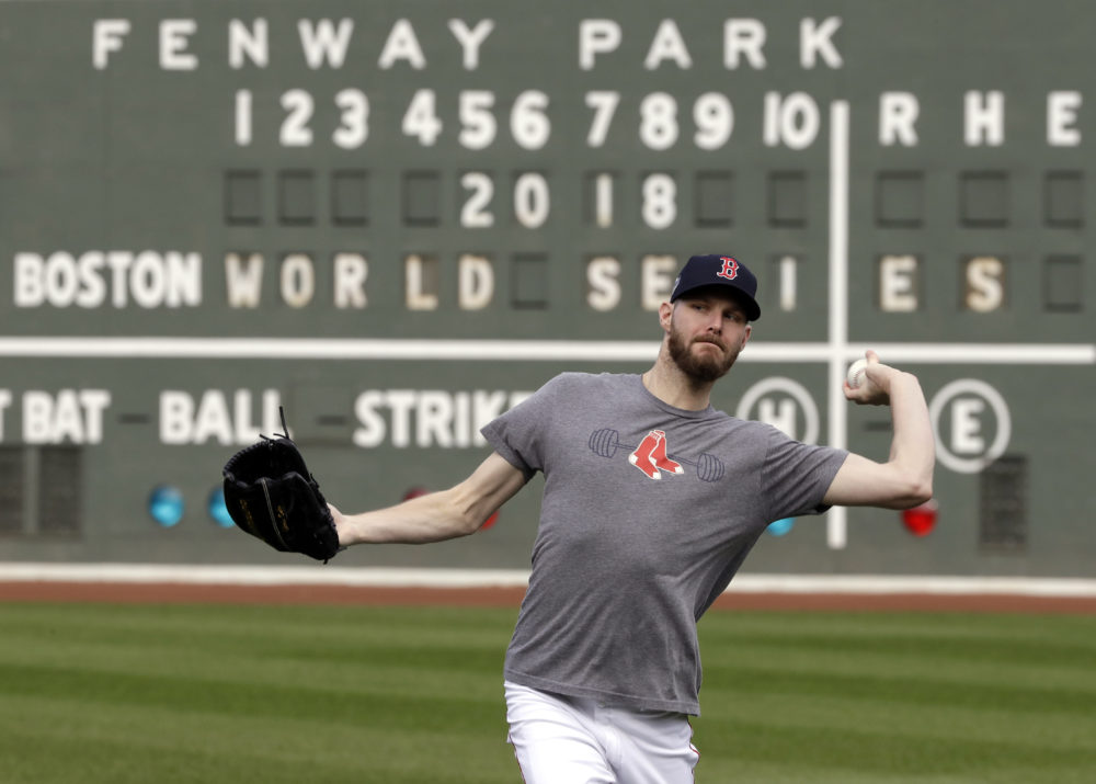 Red Sox pitcher Chris Sale throws during a workout Sunday in Boston, as he prepares to start Game 1 of the World Series against the Los Angeles Dodgers. (Elise Amendola/AP)