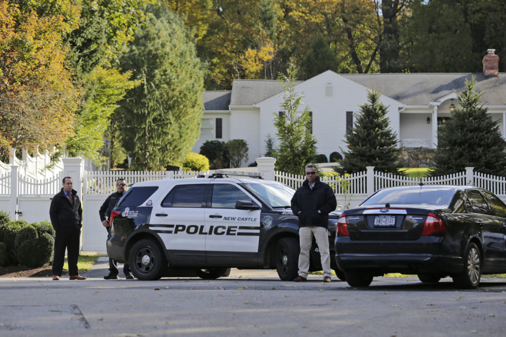 "Police officers stand in front of property owned by former Secretary of State Hillary Clinton and former President Bill Clinton in Chappaqua, N.Y., Wednesday, Oct. 24, 2018. A U.S. official says a ""functional explosive device"" was found at the Clinton's suburban New York home. (Seth Wenig/AP)"