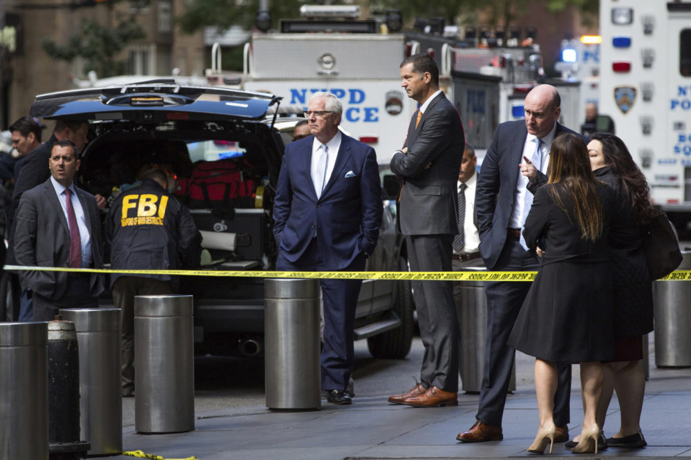 NYPD Deputy Commissioner of Intelligence & Counterterrorism John Miller, center, arrives outside Time Warner Center on Wednesday, Oct. 24, 2018, in New York. Law enforcement officials say a suspicious package that prompted an evacuation of CNN's offices is believed to contain a pipe bomb. (AP Photo/Kevin Hagen)