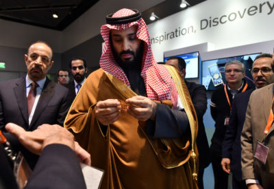 In this March 24, 2018, photo, Saudi Arabia Crown Prince Mohammed bin Salman tours an innovation gallery of Saudi Arabian technology, including an exhibit by King Abdullah University of Science and Technology, during a visit to Massachusetts Institute of Technology in Cambridge, Mass. While some U.S. colleges rethink their ties to Saudi Arabia, many more have shown no signs of backing away. An Associated Press analysis of federal data finds that 38 schools received at least $359 million from the Saudi government from 2011 through 2017.  (Josh Reynolds/AP Images for KAUST)
