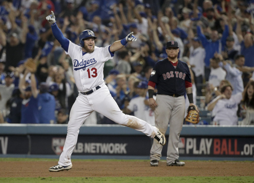 Los Angeles Dodgers' Max Muncy celebrates after his walk off home run against the Boston Red Sox during the 18th inning in Game 3 of the World Series baseball game on Saturday, Oct. 27, 2018, in Los Angeles. (Jae C. Hong/AP)
