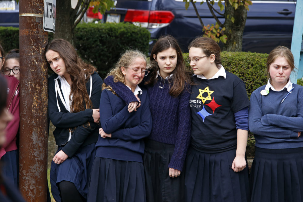 Students pay their respects to Dr. Jerry Rabinowitz, one of 11 people killed while worshipping at the Tree of Life Synagogue on Saturday Oct. 27, 2018.  (Gene J. Puskar/AP)