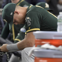 Oakland Athletics' Chad Pinder sits on the bench after the A's lost to the New York Yankees 7-2 in the American League wild-card playoff baseball game on Wednesday. (AP/Bill Kostroun)