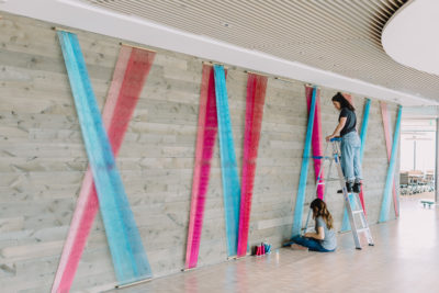 Artist Rachel Mica Weiss installs her fiber work at the Boston Consulting Group's new headquarters. (Courtesy Nicole Baas)