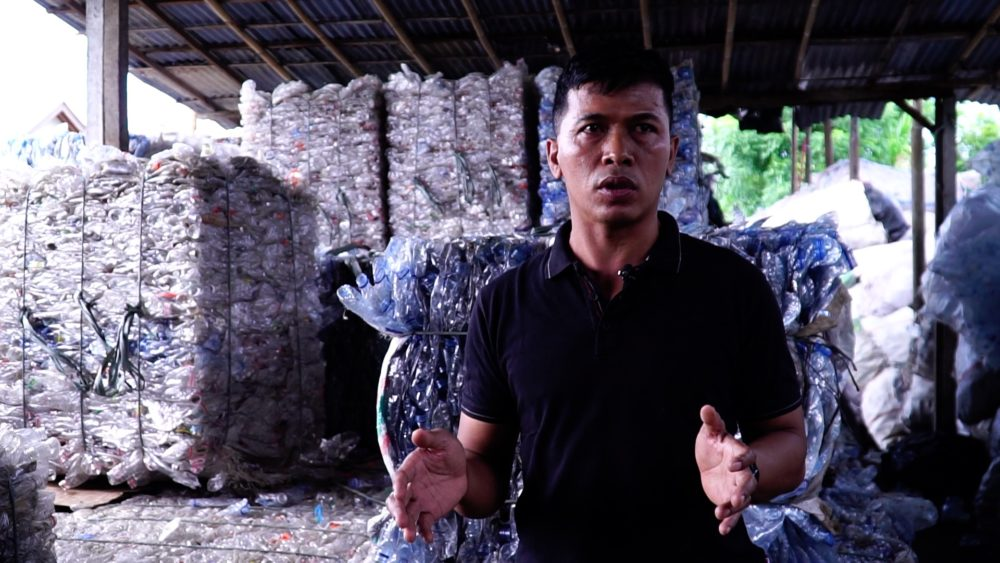 Nyoman Adi Artana at a plastic-bottle packing plant in Bali, Indonesia. (Courtesy of Niall Macaulay)