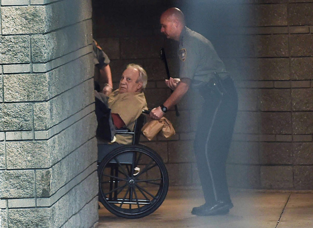 In this 2015 photo, Bobby Gentile is brought into the federal courthouse in a wheelchair for a continuation of a hearing in Hartford, Connecticut. (Cloe Poisson/The Courant via AP)