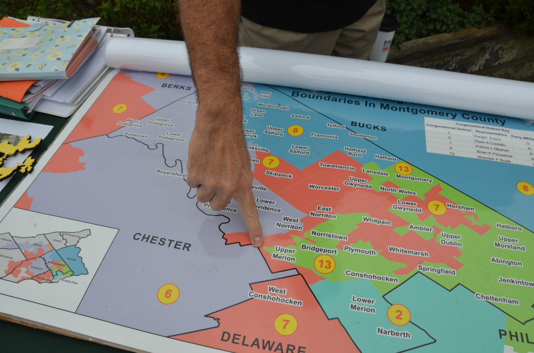 Fair Districts PA organizer Rich Rafferty points to a spot in the old PA-07 in Montgomery County. The district was just as wide as a restaurant parking lot at that point on the map. The old PA-07 was considered a poster child for gerrymandering. (Alex Schroeder/On Point)