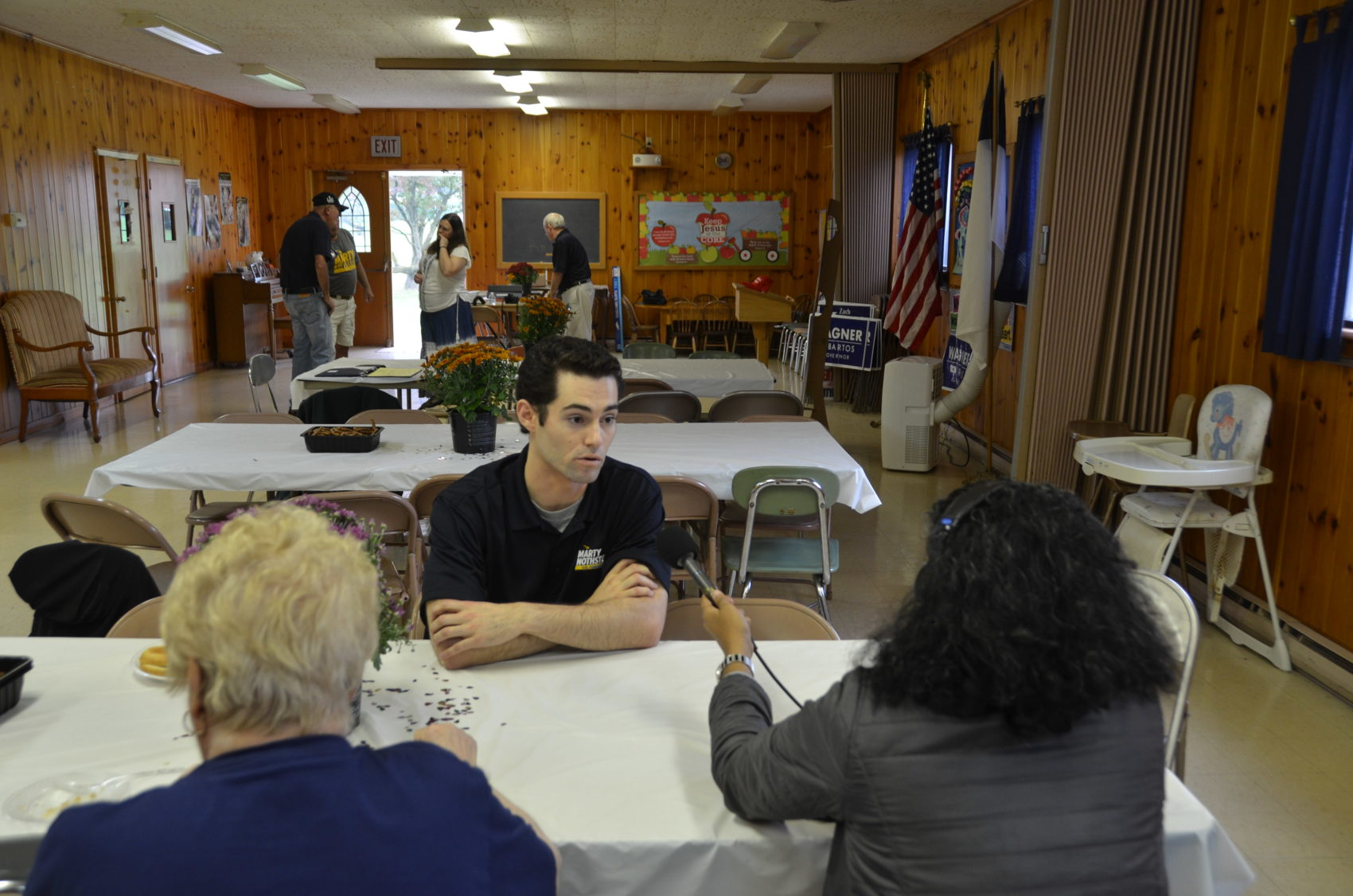 Ryan Rogers of the Marty Nothstein campaign speaks with On Pont's Meghna Chakrabarti. (Alex Schroeder/On Point)