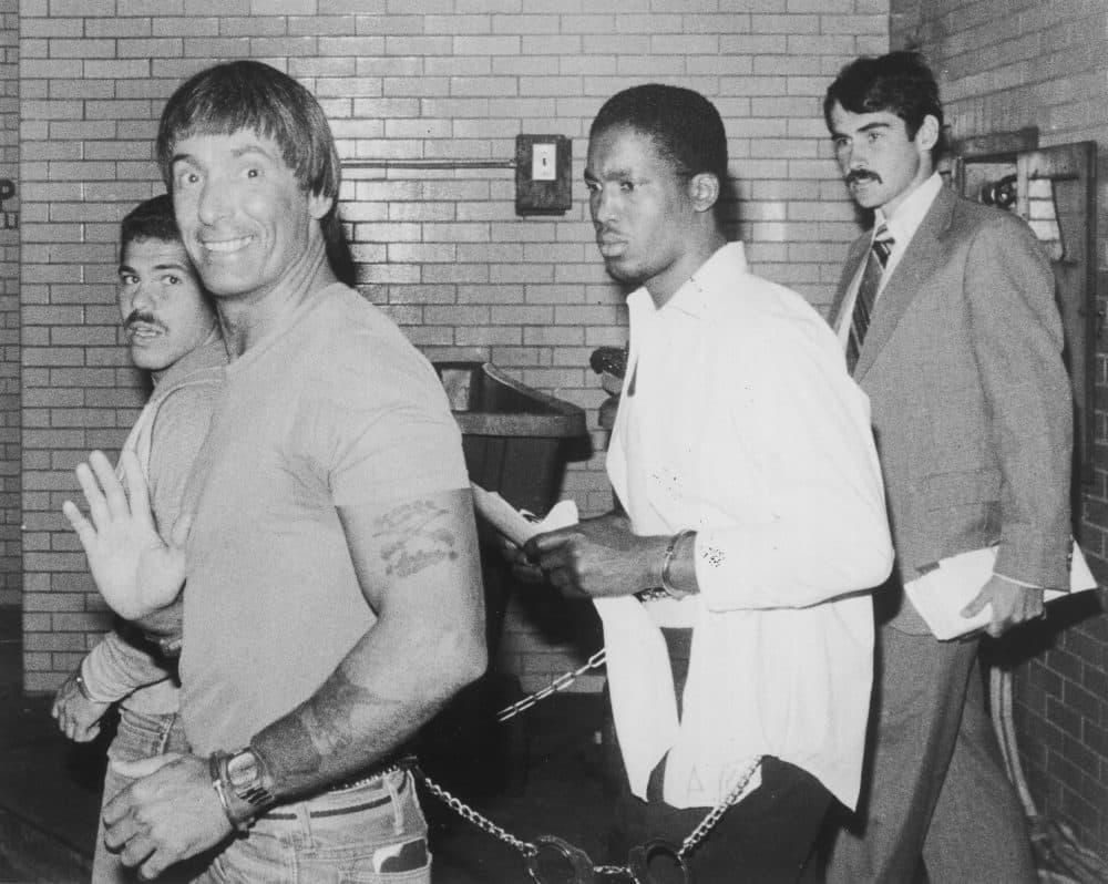 George Reissfelder waves to photographers as he arrives at Suffolk Superior Court on Aug. 30, 1982. (Courtesy Joe Runci/Boston Globe)