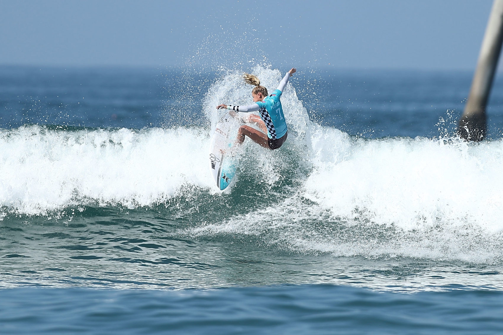 A surfer competes in the women's quarterfinals at the Vans U.S. Open of Surfing on Aug. 5, 2018 in Huntington Beach, California. Women competing at the highest levels of surfing will now win the same prize money as their male counterparts after a rules change took effect earlier this month. (Joe Scarnici/Getty Images)