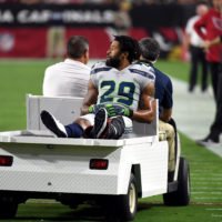 Earl Thomas is expected to miss several months with a fractured tibia. (Norm Hall/Getty Images)
