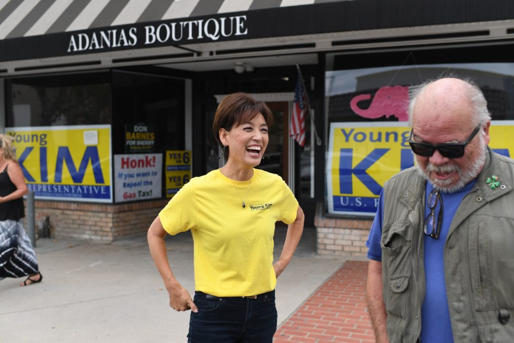 Republican candidate for Congress Young Kim, 55, laughs with a supporter outside her campaign office in Yorba Linda, California, on October 6. (Robyn Beck/AFP/Getty Images)