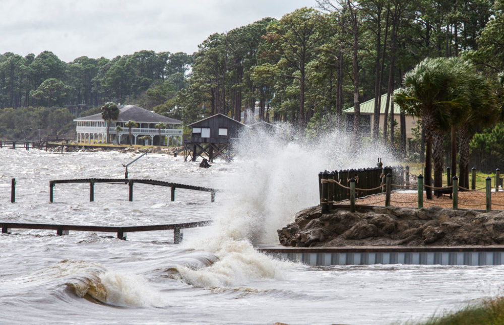 Waves crashed against a home seawall as the surge started pushing the tide higher as Hurricane Michael approached on October 9, 2018 in Eastpoint, Florida. (Mark Wallheiser/Getty Images)