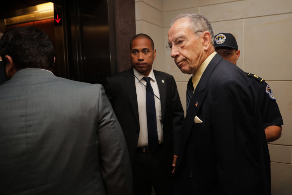 Senate Judiciary Committee Chairman Charles Grassley (R-IA) is surrounded by staff and security as he heads for a secure meeting space inside the U.S. Capitol Visitors Center to review the FBI report about alleged sexual misconduct by Supreme Court nominee Judge Brett Kavanaugh on Thursday in Washington, D.C. (Photo by Chip Somodevilla/Getty Images)