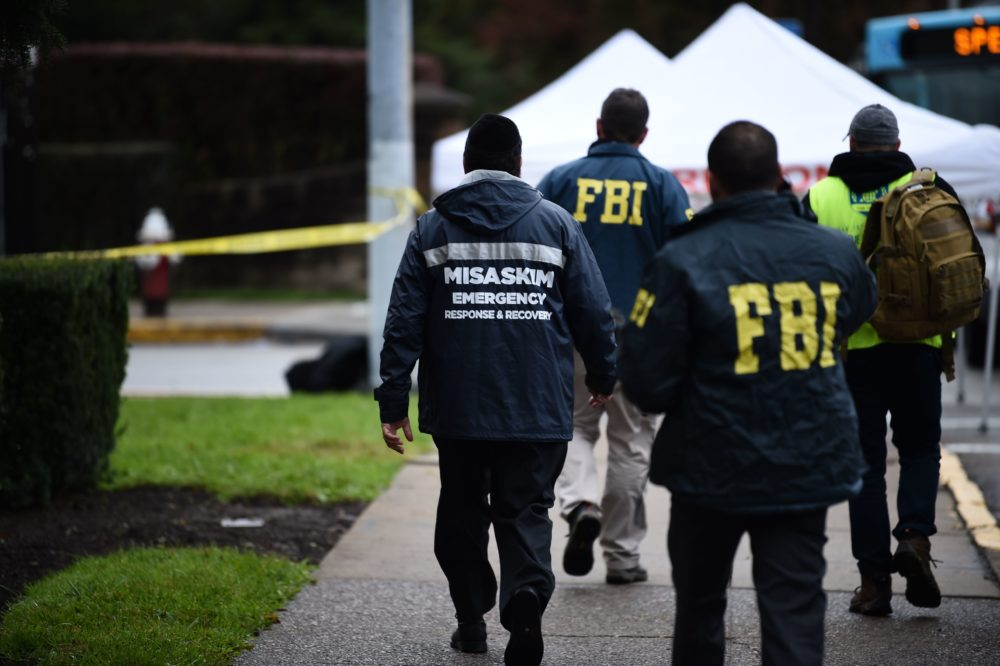 Members of the FBI and others survey the area on October 28, 2018 outside the Tree of Life Synagogue (Brendan Smialowski/AFP/Getty Images)