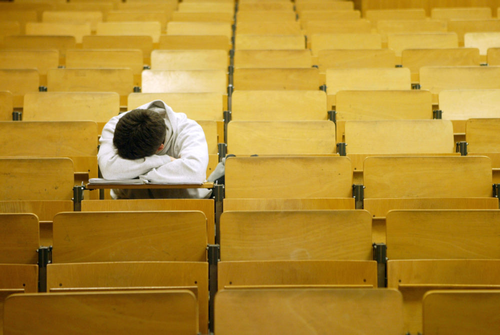 A student naps in a lecture hall in Berlin, Germany on Jan. 13, 2003. (Sean Gallup/Getty Images)