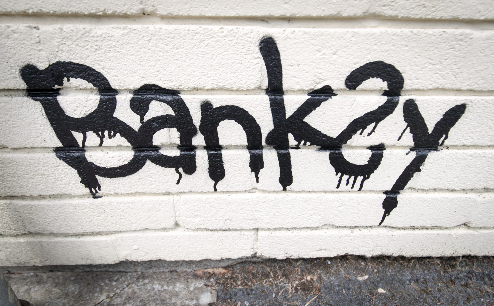 The name Banksy is left as part of a mural painted on the side of one of the classrooms at Bridge Farm Primary in Bristol, England on June 7, 2016. (Matt Cardy/Getty Images)