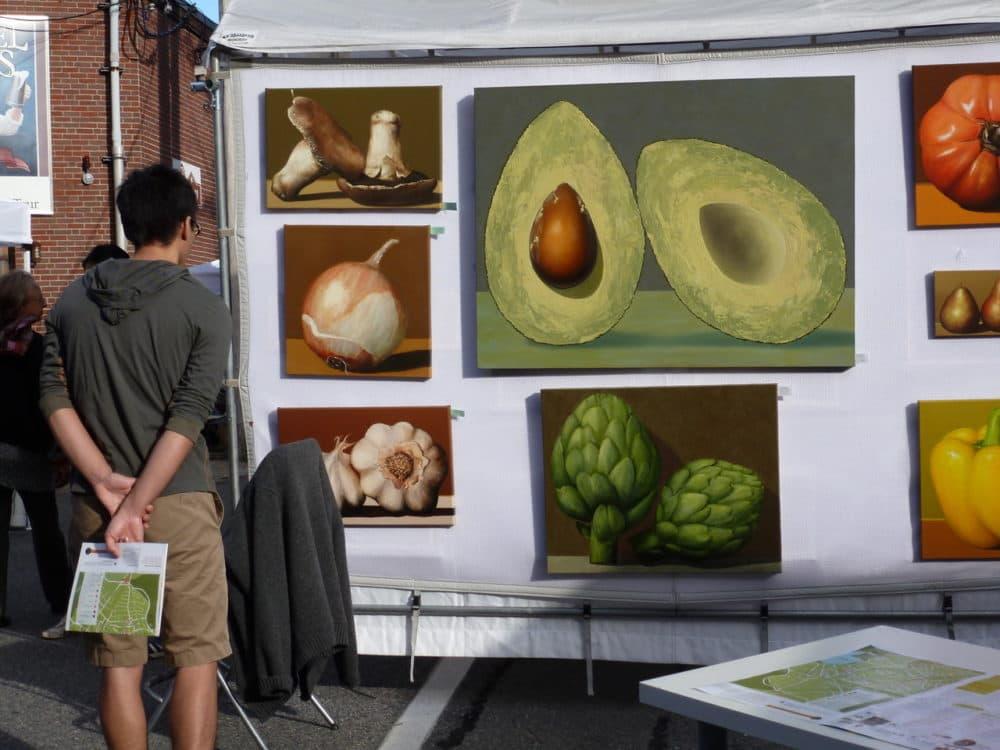 A man looks at artwork displayed during Jamaica Plain Open Studios. (Courtesy Susan Deprey)
