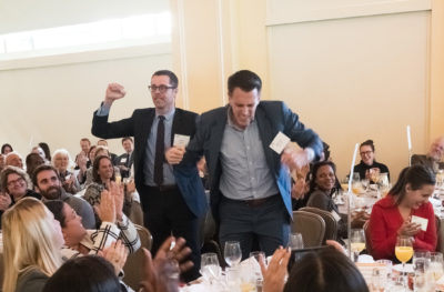 Donald McKay elementary school principal Jordan Weymer and director of operations Michael Munroe celebrate as their school is awarded the $100,000 Thomas W. Payzant School on the Move prize. (Courtesy of Edvestors)