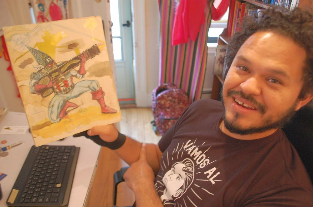 Medford artist Raul Gonzalez III at his home studio (Dana Forsythe for WBUR)