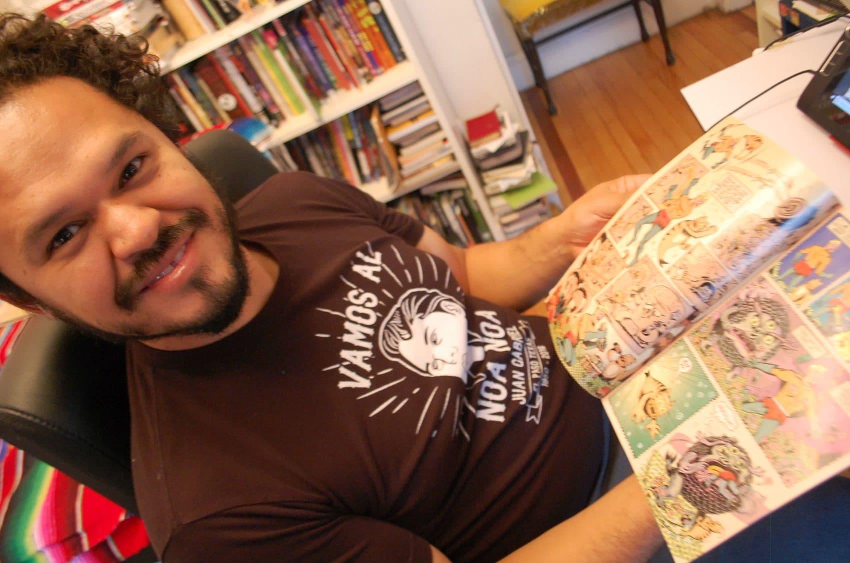 Raul Gonzalez shows off his work on the SpongeBob comic book (Dana Forsythe for WBUR)