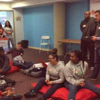 """The Boston-based restaurant software company Toast hosted middle school students for the """"Guppy Tank"""" business pitch contest in 2017. (Courtesy of TUGG)"""