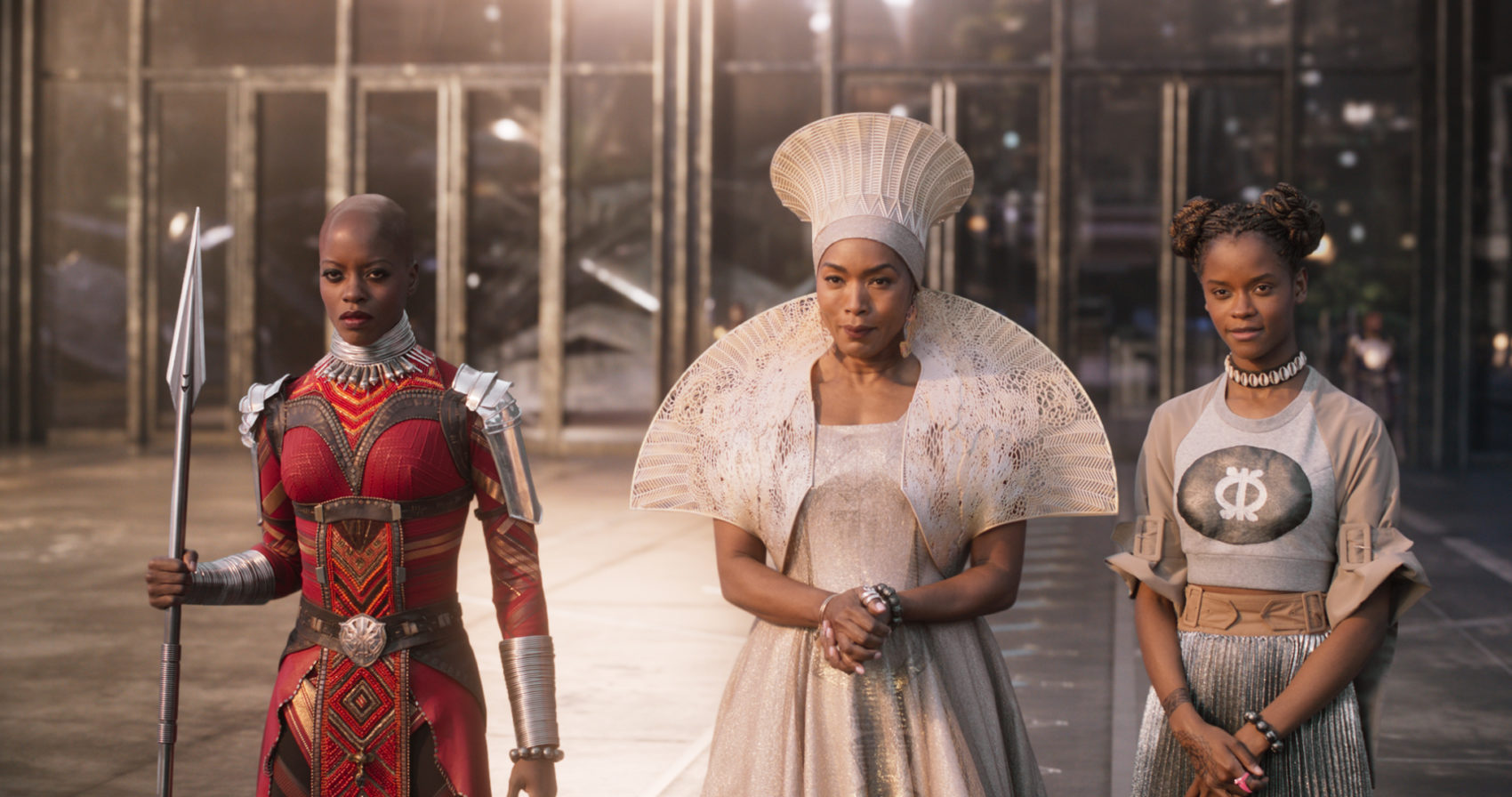 Marvel Studios' BLACK PANTHER .Left to right: Ayo (Florence Kasumba), Ramonda (Angela Bassett) and Shuri (Leititia Wright)..Ph: Film Frame..©Marvel Studios 2018