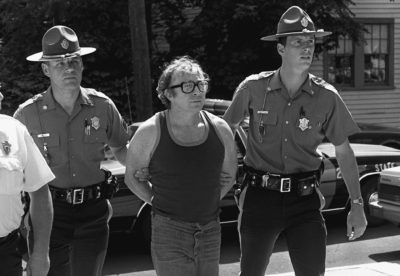 Myles Connor is brought into a Dedham courthouse on July 9, 1985. (George Rizer/Boston Globe)