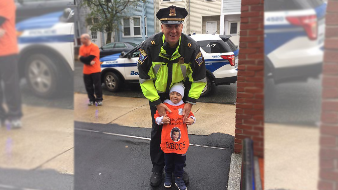 Christopher Chavarria poses with Capt. Kelley McCormick outside East Boston Central Catholic School. (Courtesy Yohana Velasquez)