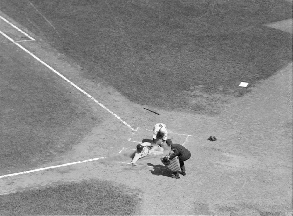 A play at home during a Red Sox-Yankees game at Fenway Park on July 3, 1932 -- the first-ever Sunday game at Fenway. (Courtesy of the Boston Public Library, Leslie Jones Collection)