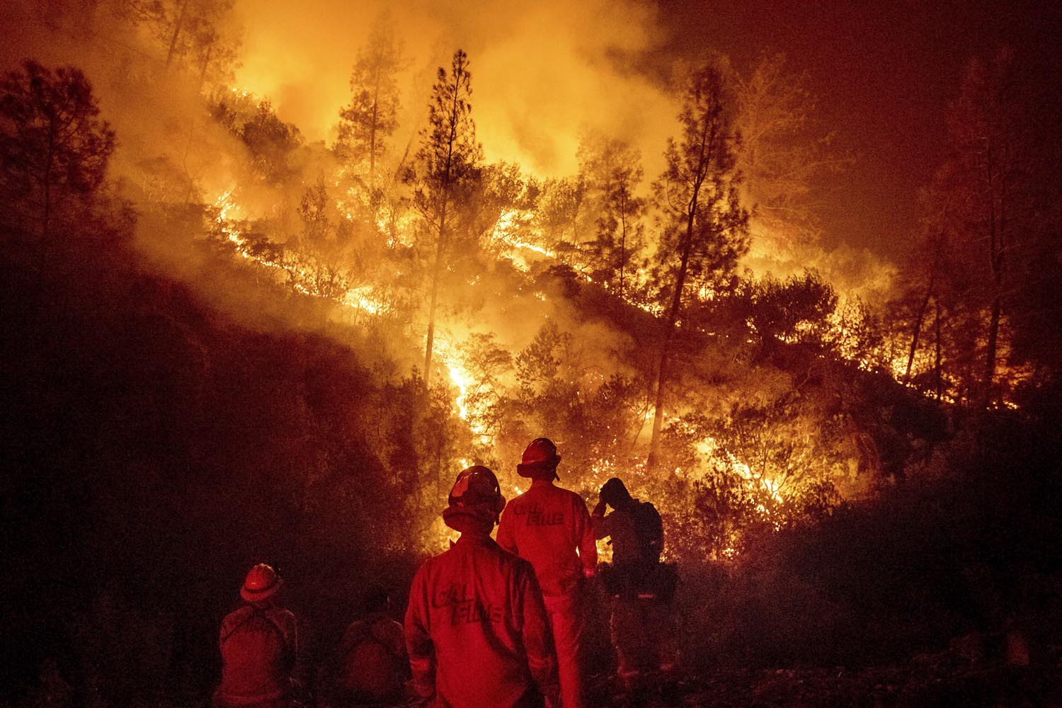 In this Aug. 7, 2018 file photo, firefighters monitor a backfire while battling the Ranch Fire, part of the Mendocino Complex Fire near Ladoga, Calif. (Noah Berger/AP)