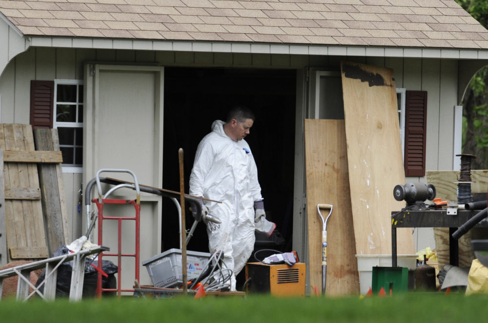 A law enforcement agent searches a shed behind the home of reputed Connecticut mobster Bobby Gentile in Manchester, Connecticut, on May 10, 2012. (Jessica Hill/AP)