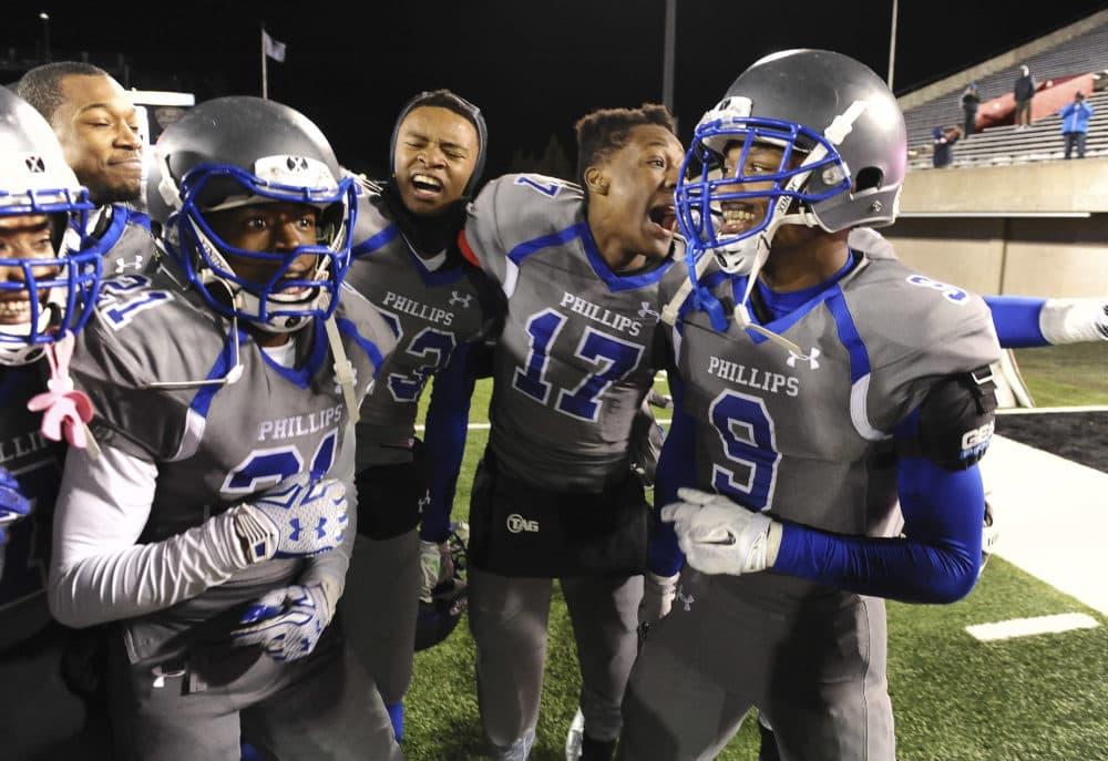 "A recent study says that, among the 10 most popular boys' high school sports, football ranks lowest in net health benefits, but secondin ""psychosocial benefits. (Matt Marton/AP)"