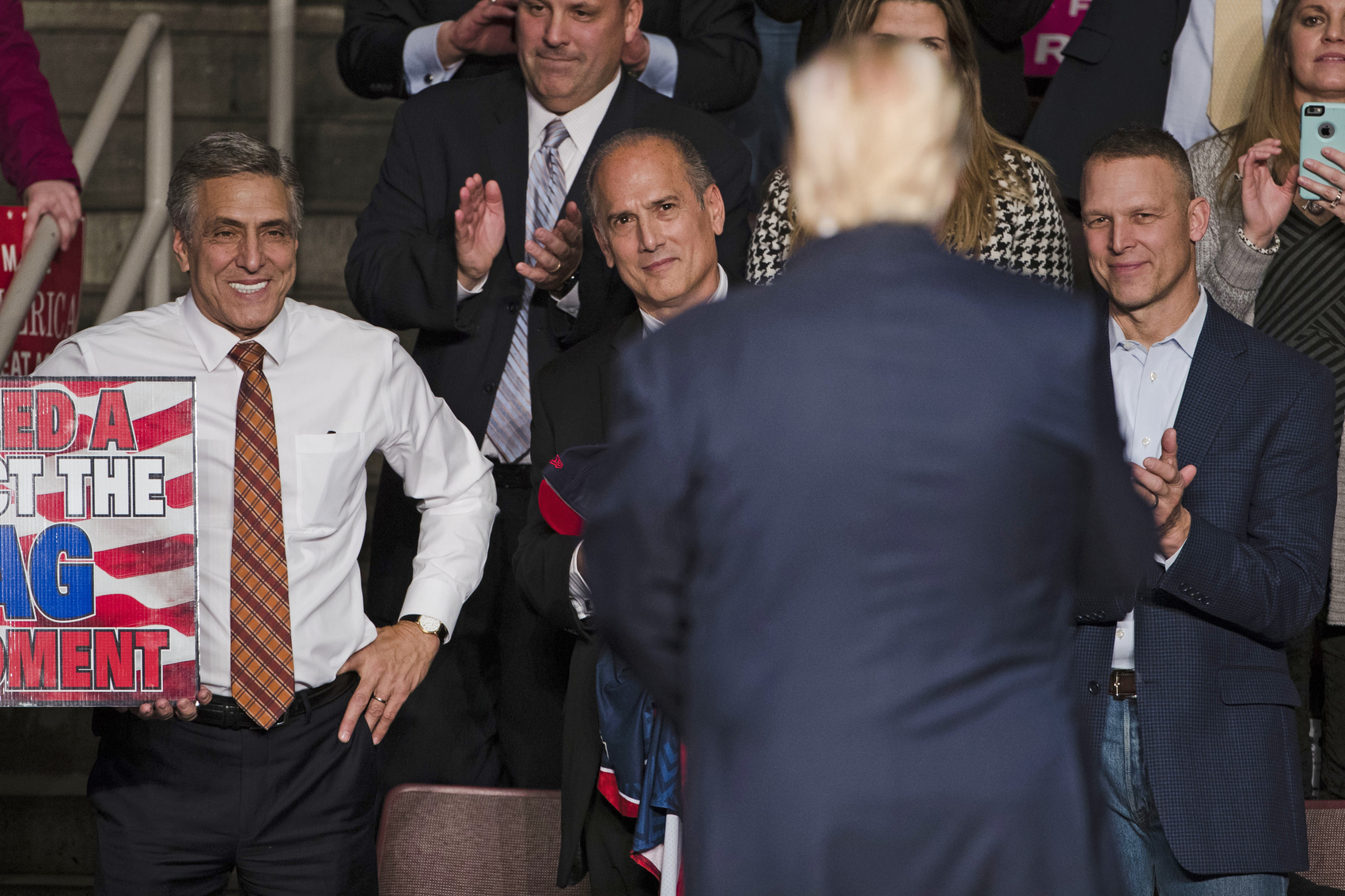 FILE - In this Dec. 15, 2016, file photo, U.S. Rep. Lou Barletta, R-Pa., left, U.S. Rep. Tom Marino, R-Pa., center left, and U.S. Rep. Scott Perry, R-Pa., right, watch as President-elect Donald Trump, center right, departs a rally in Hershey, Pa. The Democratic-controlled Pennsylvania Supreme Court struck down the state's congressional map in a 4-3 decision Monday, Jan. 22, 2018, granting a major victory to Democrats who charged that the 18 districts were unconstitutionally gerrymandered to benefit Republicans. (AP Photo/Matt Rourke, File)