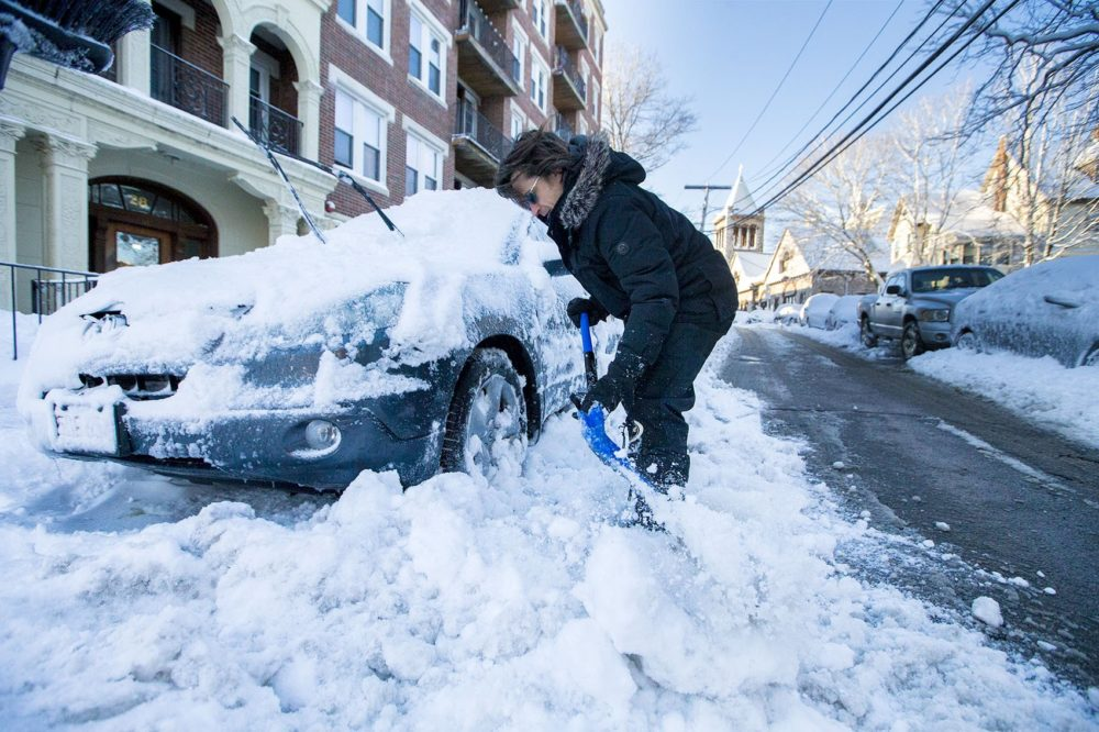 In March, a man shovels his car out of the snow on Park Vale Avenue in Allston. (Jesse Costa/WBUR)