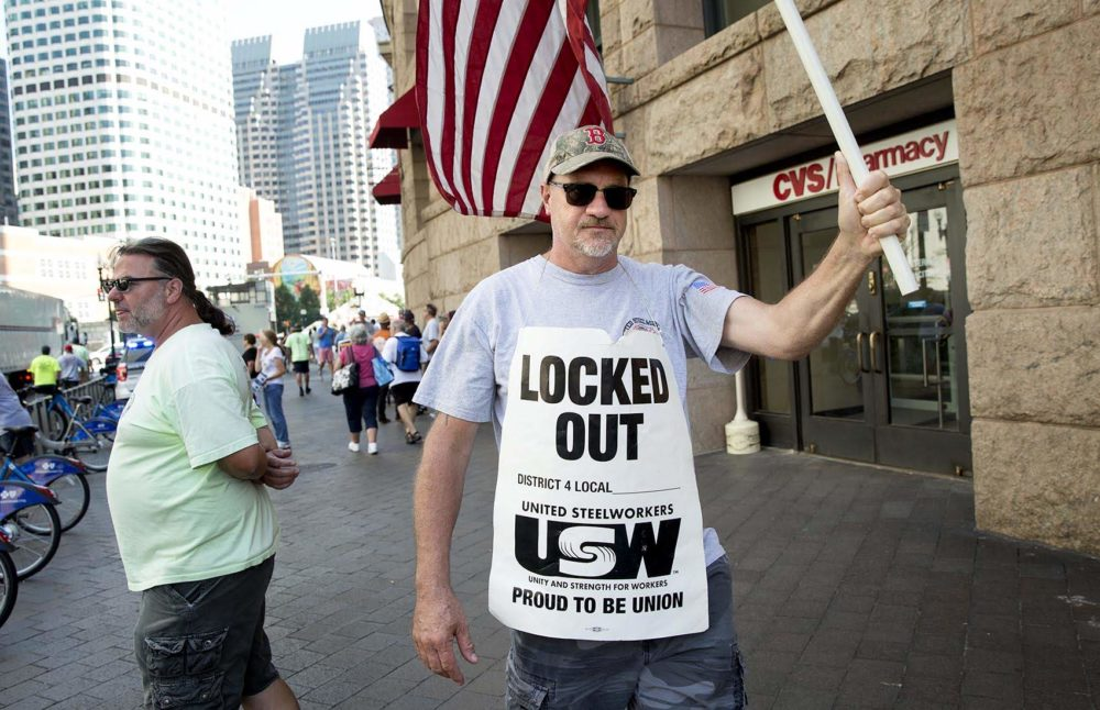 Outside South Station, Charlie Webber, of United Steelworkers, protests the National Grid lockout in late August. (Robin Lubbock/WBUR)