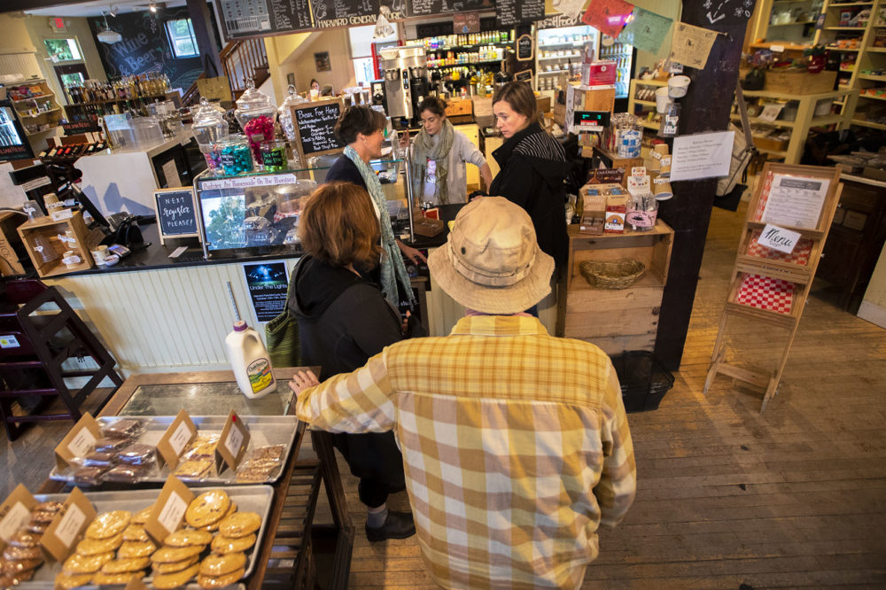 Patrons wait in line at the General Store in Harvard, Massachusetts.(Jesse Costa/WBUR)